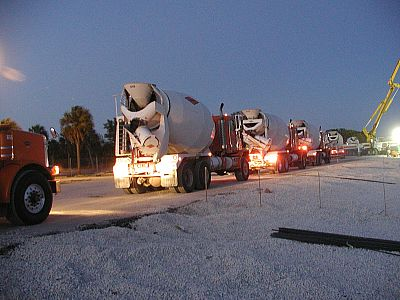 Trucks line up to supply the concrete to the boom pump